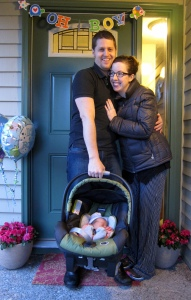 My husband holds the Chicco infant car seat with ease on Charlie's first day home.